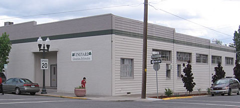Image of the Vineyard Christian Fellowship building at the corner of Klamath Ave and 4th Street in Klamath Falls